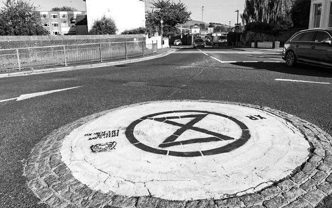 XR symbol on mini roundabout